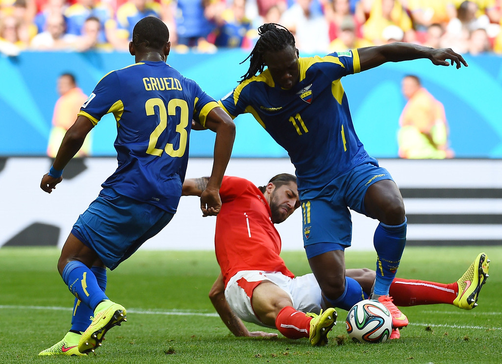 . Switzerland\'s defender Ricardo Rodriguez (C) vies with Ecuador\'s midfielder Carlos Gruezo (L) and Ecuador\'s forward Felipe Caicedo during a Group E football match between Switzerland and Ecuador at the Mane Garrincha National Stadium in Brasilia during the 2014 FIFA World Cup on June 15, 2014.    AFP PHOTO/ ANNE-CHRISTINE POUJOULAT