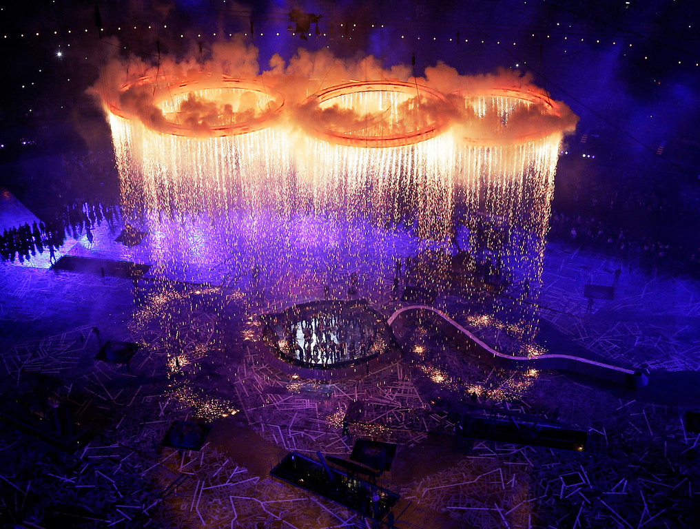 . In this July 27, 2012 file photo, the Olympic rings light up the stadium during the Opening Ceremony at the 2012 Summer Olympics in London. (AP Photo/Morry Gash, Pool, File)