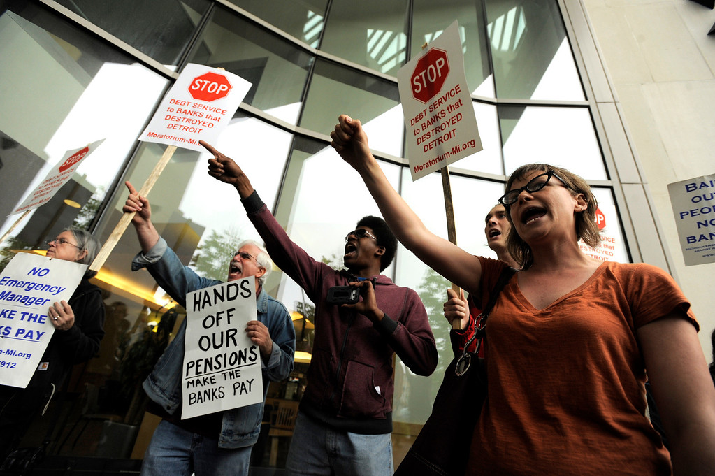 . Protesters yell after being shut out of a public informational meeting at Wayne State University\'s Law School in Detroit, Monday evening, June 10, 2013. State-appointed emergency manager Kevyn Orr told people attending the meeting that the chances Detroit can avoid bankruptcy are about 50-50. (AP Photo/Detroit News, David Guralnick)