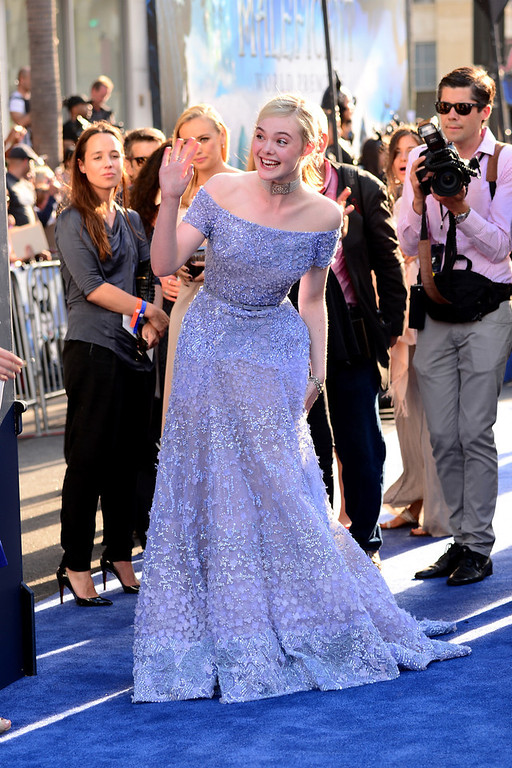 """. Actress Elle Fanning arrives at the World Premiere Of Disney\'s \""""Maleficent\"""" at the El Capitan Theatre on May 28, 2014 in Hollywood, California.  (Photo by Frazer Harrison/Getty Images)"""