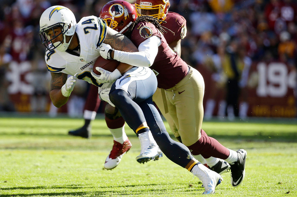 . San Diego Chargers running back Ryan Mathews is stopped by Washington Redskins strong safety Brandon Meriweather during the first half of a NFL football game in Landover, Md., Sunday, Nov. 3, 2013. (AP Photo/Alex Brandon)