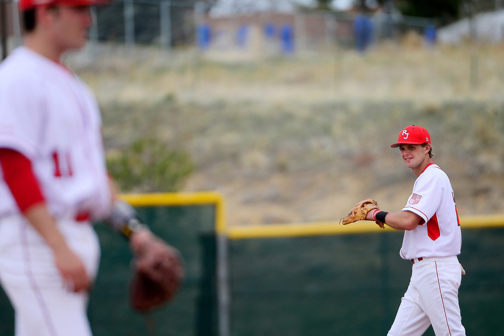 . PARKER, CO - APRIL 29: Regis Jesuit shortstop Brody Weiss walks back into position between pitches during the team\'s final home game. Weiss is the son of Colorado Rockies manager Walt Weiss. (Photo by AAron Ontiveroz/The Denver Post)