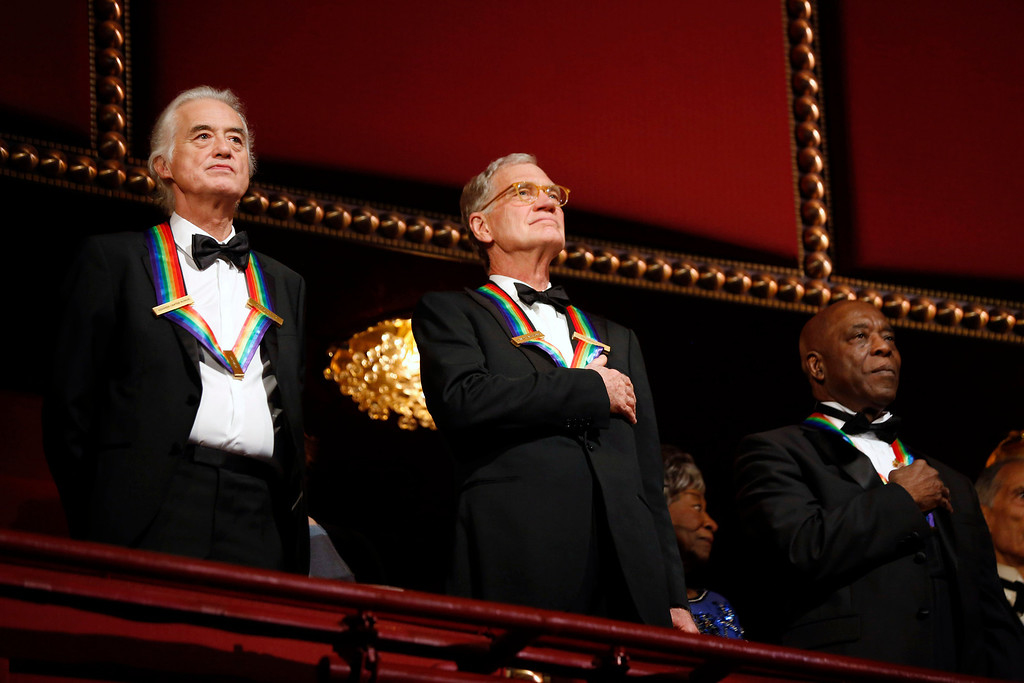 """. Kennedy Center honorees (L-R) Led Zeppelin band member Jimmy Page, late-night TV host David Letterman and blues musician George \""""Buddy\"""" Guy appear on the balcony as they attend the 2012 Kennedy Center Honors at the Kennedy Center in Washington, December 2, 2012.     REUTERS/Jason Reed"""