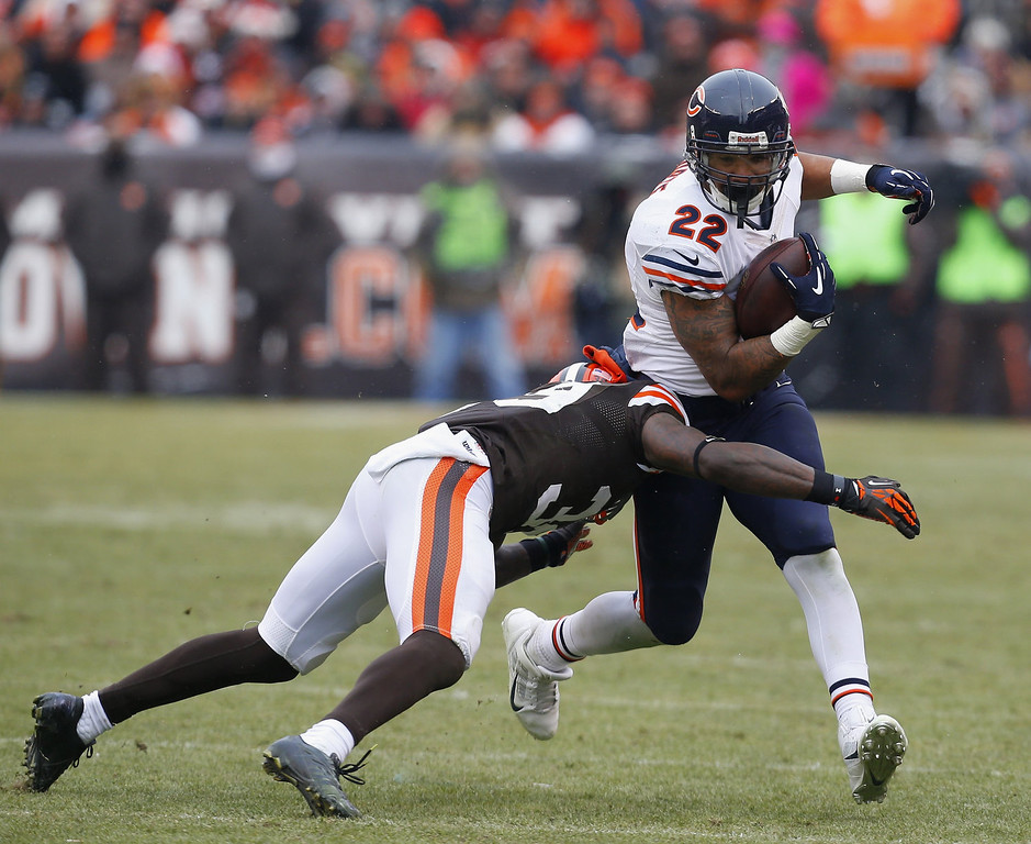 . Running back Matt Forte #22 of the Chicago Bears runs the ball as he is hit by defensive back Jordan Poyer #33 of the Cleveland Browns at FirstEnergy Stadium on December 15, 2013 in Cleveland, Ohio.  (Photo by Matt Sullivan/Getty Images)
