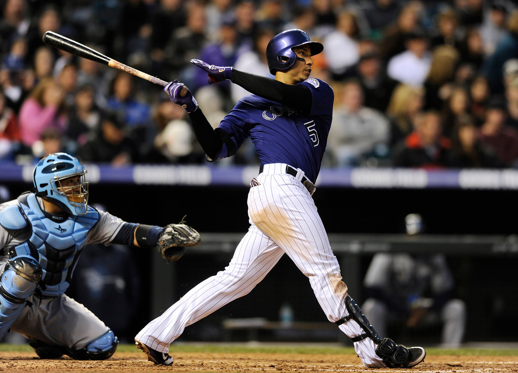 . Colorado Rockies\' Carlos Gonzalez watches the flight of his solo home run off Tampa Bay Rays starting pitcher David Price during the fifth inning of a baseball game Saturday, May 4, 2013, in Denver. (AP Photo/Jack Dempsey)