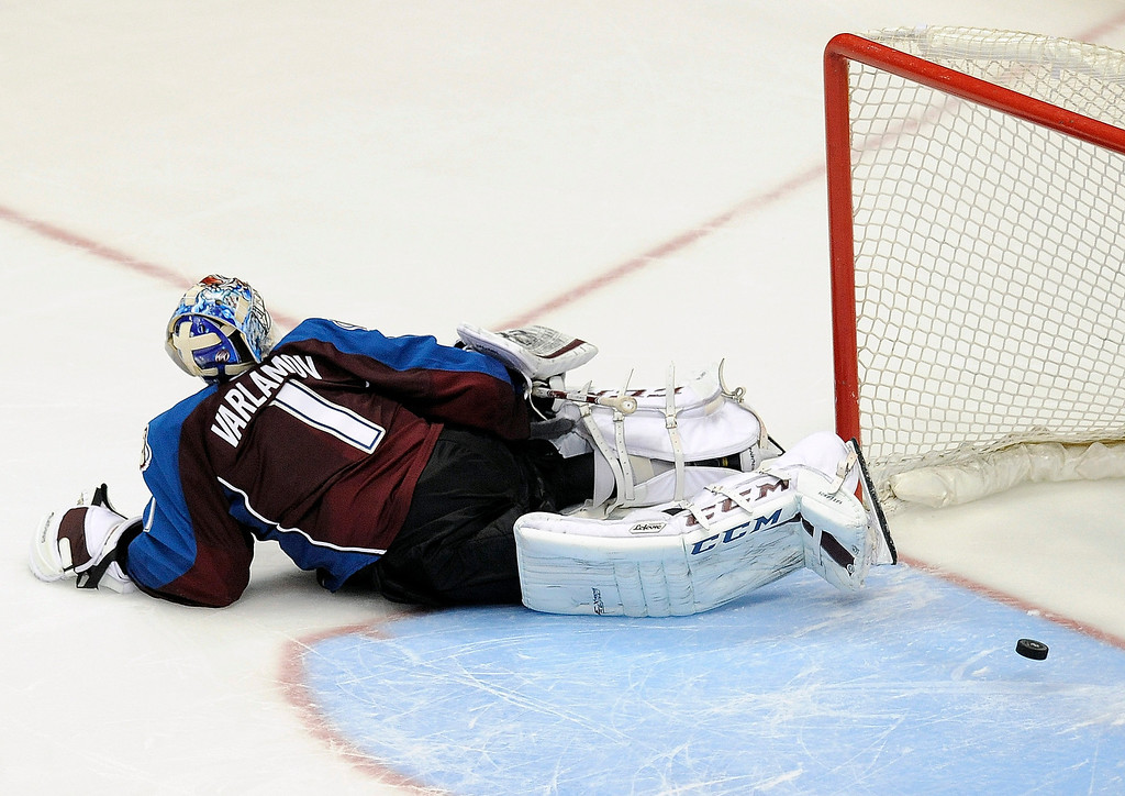 . Colorado Avalanche goalie Semyon Varlamov lies on the ice after Pittsburgh Penguins left wing Jussi Jokinen scored in the shootout of an NHL hockey game Sunday, April 6, 2014, in Denver. The Penguins won 3-2. (AP Photo/Chris Schneider)