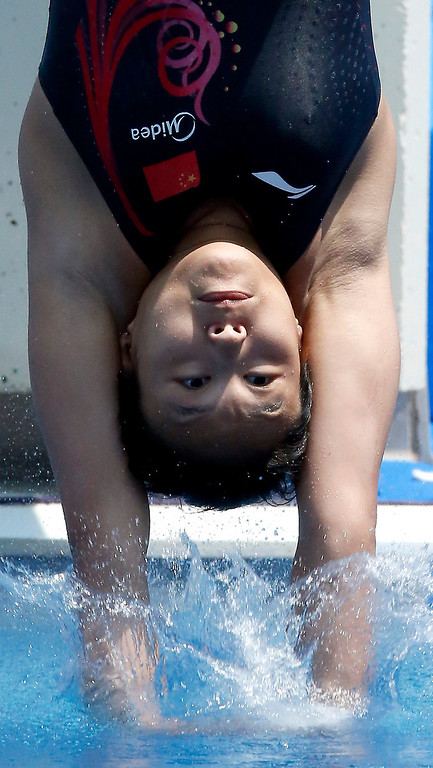 . Wang Han from China performs during the women\'s 1-meter springboard preliminary at the FINA Swimming World Championships in Barcelona, Spain, Sunday, July 21, 2013. (AP Photo/Michael Sohn)
