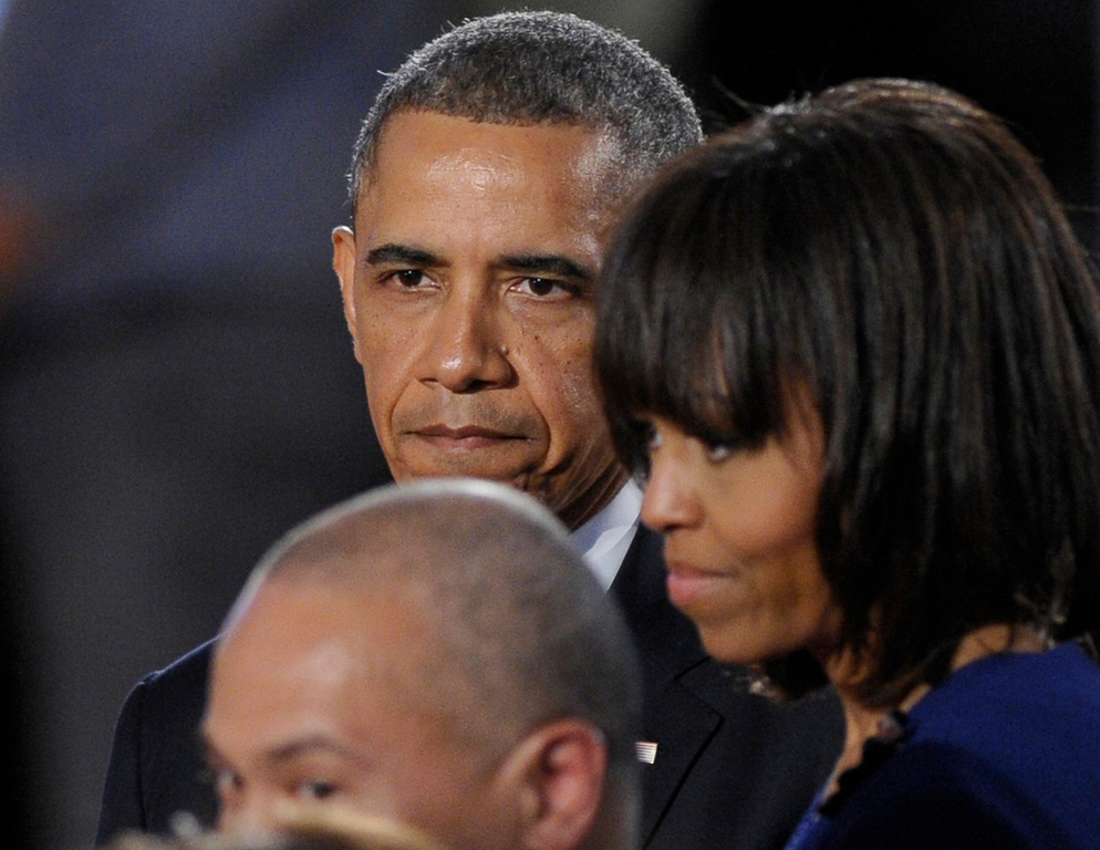 """. President Barack Obama, first lady Michelle Obama and Massachusetts Gov. Deval Patrick attend the \""""Healing Our City: An Interfaith Service\"""" at the Cathedral of the Holy Cross in Boston, Thursday, April 18, 2013. (AP Photo/Susan Walsh)"""