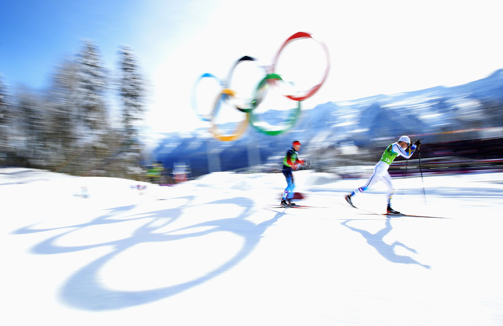 . SOCHI, RUSSIA - FEBRUARY 19:  Teodor Peterson of Sweden and Nikita Kriukov of Russia compete in the Men\'s Team Sprint Classic Semifinals during day 12 of the 2014 Sochi Winter Olympics at Laura Cross-country Ski & Biathlon Center on February 19, 2014 in Sochi, Russia.  (Photo by Richard Heathcote/Getty Images)