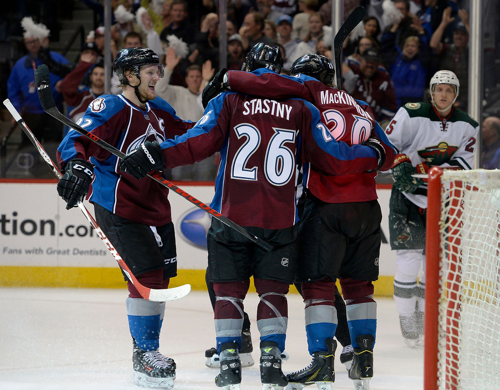 . Paul Stastny (26) of the Colorado Avalanche celebrates his third period empty net goal with Nathan MacKinnon (29) and Gabriel Landeskog. The Avalanche won 4 to 2.  The Colorado Avalanche hosted the Minnesota Wild in the first round of the Stanley Cup Playoffs at the Pepsi Center in Denver, Colorado on Saturday, April 19, 2014. (Photo by John Leyba/The Denver Post)