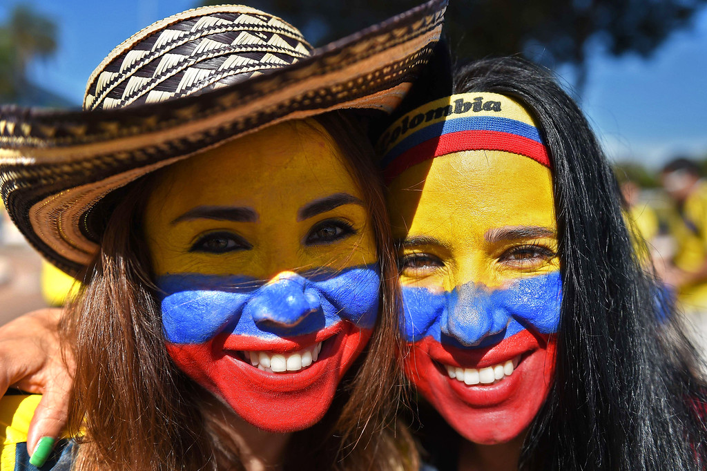 . Colombia\'s fans pose outside the Mane Garrincha National Stadium in Brasilia, before the Group C football match between Colombia and Ivory Coast on June 19, 2014 during the 2014 FIFA World Cup on June 19, 2014.  AFP PHOTO / EITAN  ABRAMOVICH/AFP/Getty Images