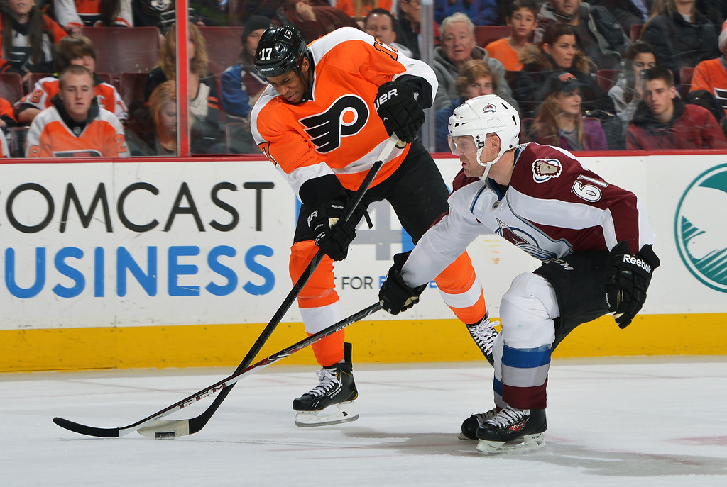 . PHILADELPHIA, PA - FEBRUARY 06: Wayne Simmonds #17 of the Philadelphia Flyers takes a shot past Andre Benoit #61 of the Colorado Avalanche at the Wells Fargo Center on February 6, 2014 in Philadelphia, Pennsylvania.  (Photo by Drew Hallowell/Getty Images)