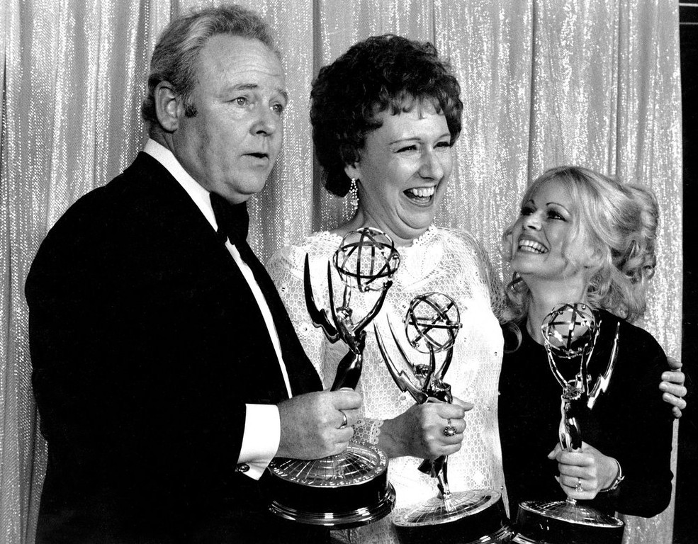 """. Cast members of \""""All in the Family,\"""" from left, Carroll O\'Connor, Jean Stapleton, and Sally Struthers pose with their Emmys backstage at the 24th annual Emmy Awards in Hollywood, Ca., Sunday night, May 14, 1972. O\'Connor and Stapleton won outstanding continued performance by an actor and actress in a leading role in a comedy series. Struthers tied in the category of outstanding performance by an actress in a supporting role in a comedy. Stapleton has died at the age of 90. John Putch said Saturday, June 1, 2013 that his mother died Friday, May 31, 2013 of natural causes at her New York City home surrounded by friends and family. (AP Photo)"""