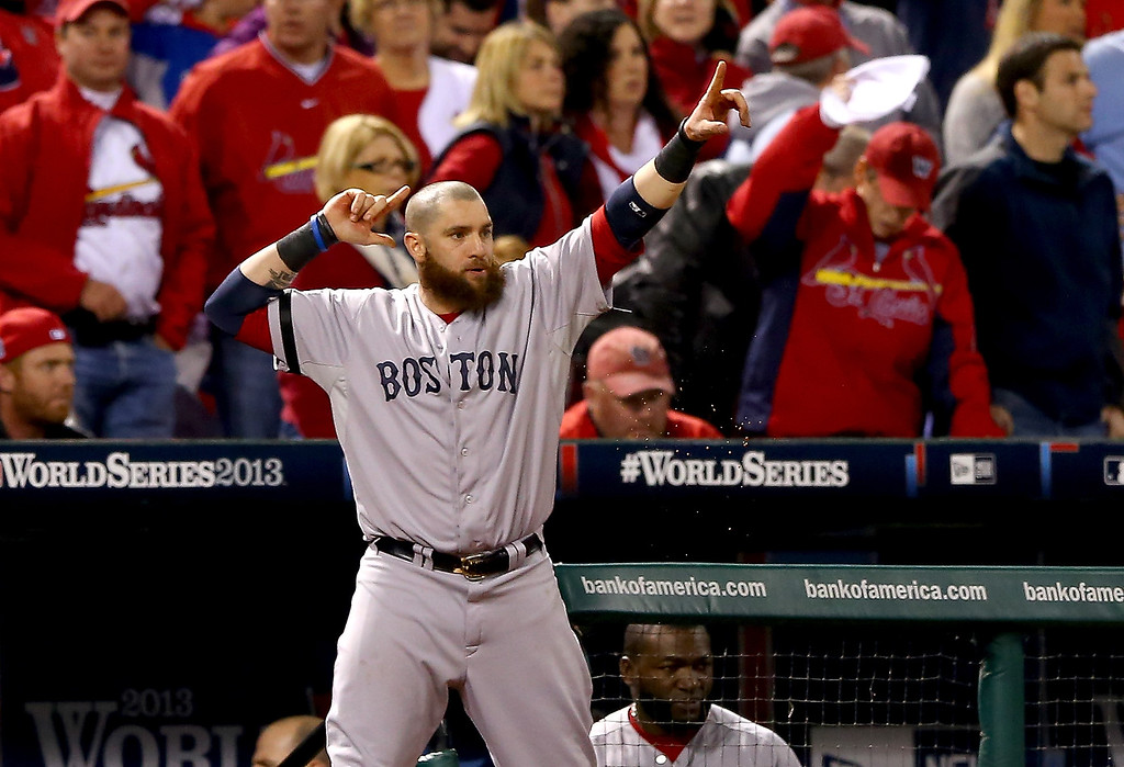 . Jonny Gomes #5 of the Boston Red Sox celebrates a RBI double by David Ross #3 scoring Xander Bogaerts #72 in the seventh inning against the St. Louis Cardinals during Game Five of the 2013 World Series at Busch Stadium on October 28, 2013 in St Louis, Missouri.  (Photo by Elsa/Getty Images)