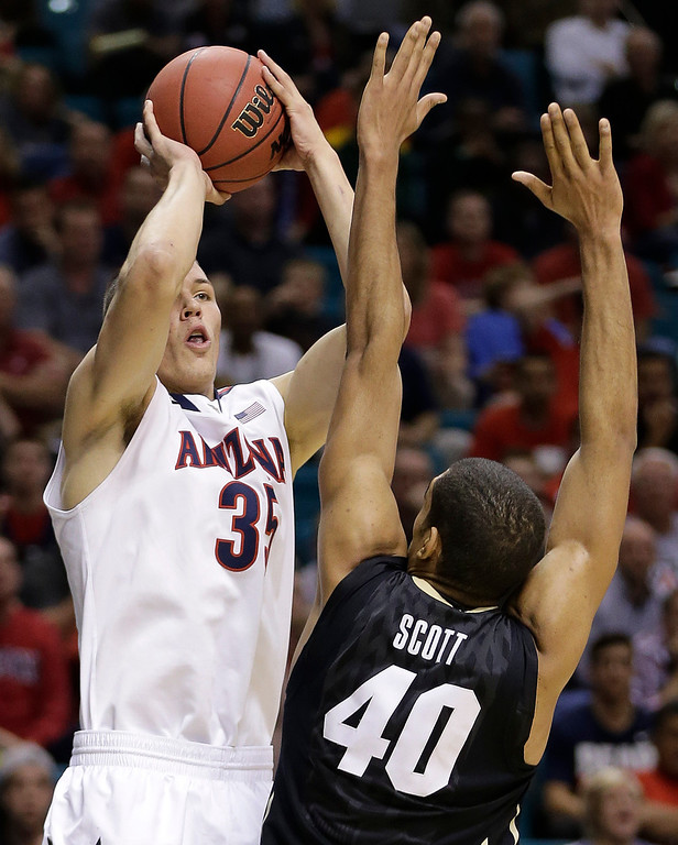. Arizona\'s Kaleb Tarczewski shoots against Colorado\'s Josh Scott during the first half of an NCAA college basketball game in the semifinals of the Pac-12 Conference on Friday, March 14, 2014, in Las Vegas. (AP Photo/Julie Jacobson)