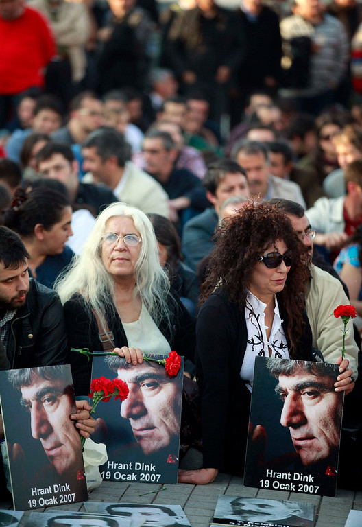 . Human rights activists hold pictures of slain Turkish-Armenian journalist Hrant Dink at Taksim square in central Istanbul April 24, 2013, during a demonstration to commemorate the 1915 mass killing of Armenians in the Ottoman Empire. REUTERS/Osman Orsal