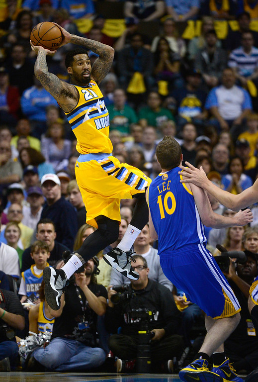 . DENVER, CO. - APRIL 20: Denver Nuggets shooting guard Wilson Chandler (21) looks to pass after saving a loose ball in the first quarter. The Denver Nuggets took on the Golden State Warriors in Game 1 of the Western Conference First Round Series at the Pepsi Center in Denver, Colo. on April 20, 2013. (Photo by AAron Ontiveroz/The Denver Post)