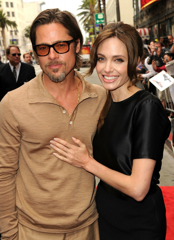 """. Actors Brad Pitt (L) and Angelina Jolie arrive at the Los Angeles premiere Of DreamWorks Animation\'s \""""Kung Fu Panda 2\"""" held at Grauman\'s Chinese Theatre on May 22, 2011 in Hollywood, California.  (Photo by Kevin Winter/Getty Images)"""