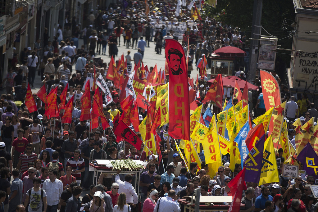 . Protestors wave their flags in Taksim Square on June 4, 2013 in Istanbul, Turkey.  (Photo by Uriel Sinai/Getty Images)