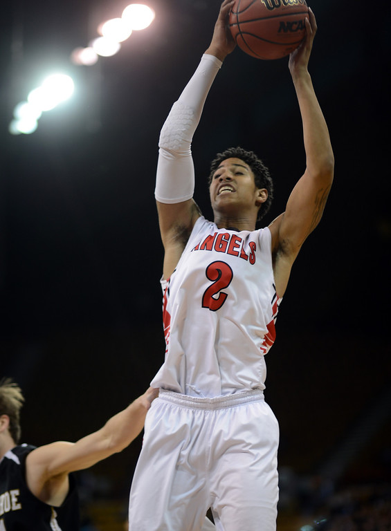 . DENVER, CO. - MARCH 08: Javon Griffin #2 of East High School rebounds during during 5A State quarter final game against Arapahoe High School at Denver Coliseum. East won 60-55. March 8, 2013. Denver, Colorado. (Photo By Hyoung Chang/The Denver Post)