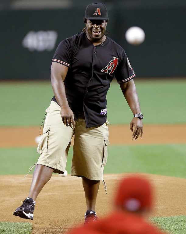 . Arizona Cardinals football team\'s first-round NFL draft pick Jonathan Cooper throws out the ceremonial first pitch before the Arizona Diamondbacks and the Colorado Rockies play a baseball game on Friday, April 26, 2013, in Phoenix. (AP Photo/Matt York)