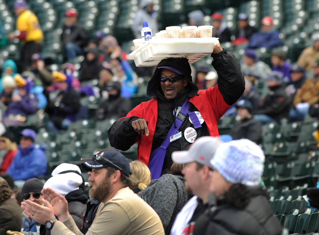 . DENVER, CO. - APRIL 23:  Coors Field vendor Bryan Simmons tried to interest fans in hot chocolate Tuesday. The Atlanta Braves defeated the Colorado Rockies 4-3 at Coors Field Tuesday, April 23, 2013.  The first game of the doubleheader Tuesday was a make-up from Monday night\'s postponement due to weather.  Photo By Karl Gehring/The Denver Post