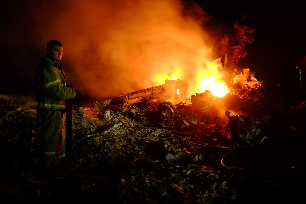 . A firefighter stands as flames burst amongst the wreckages of the malaysian airliner carrying 298 people from Amsterdam to Kuala Lumpur after it crashed, near the town of Shaktarsk, in rebel-held east Ukraine, on July 17, 2014. There were 298 people, including 154 Dutch nationals, on board the Malaysia Airlines flight that crashed in strife-torn eastern Ukraine on Thursday, an official from the carrier said. AFP PHOTO/DOMINIQUE FAGET/AFP/Getty Images