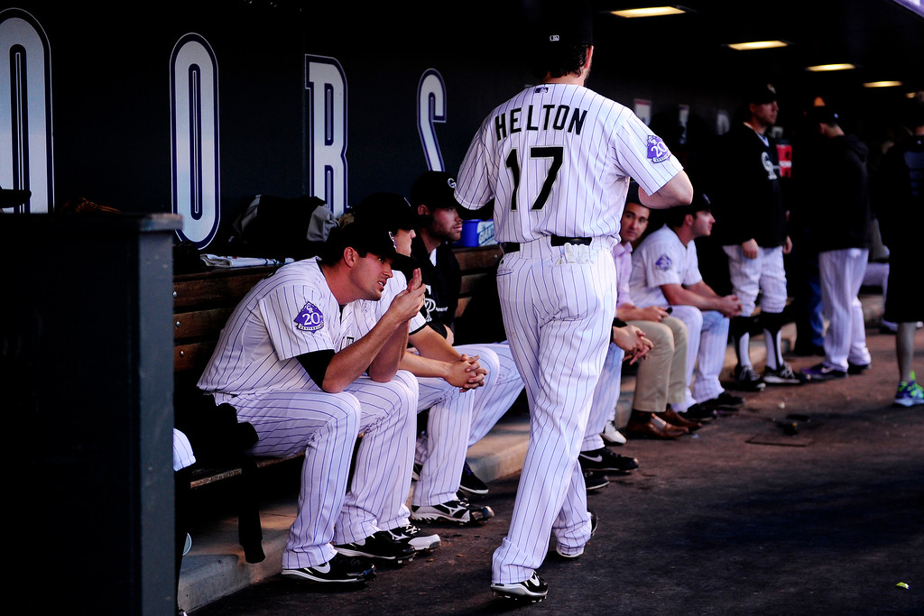 . Todd Helton walks through the dugout before the start of action in Denver. The Colorado Rockies hosted the Boston Red Sox and said farewell to longtime first baseman Todd Helton, who recently announced his retirement following this season. (Photo by AAron Ontiveroz/The Denver Post)