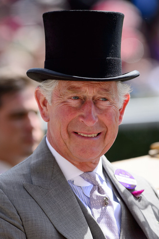 . Britain\'s Prince Charles, Prince of Wales arrives into the Parade Ring on the first day of the Royal Ascot horse racing meet, in Berkshire, west of London, on June 17, 2014.  AFP PHOTO / LEON NEAL/AFP/Getty Images
