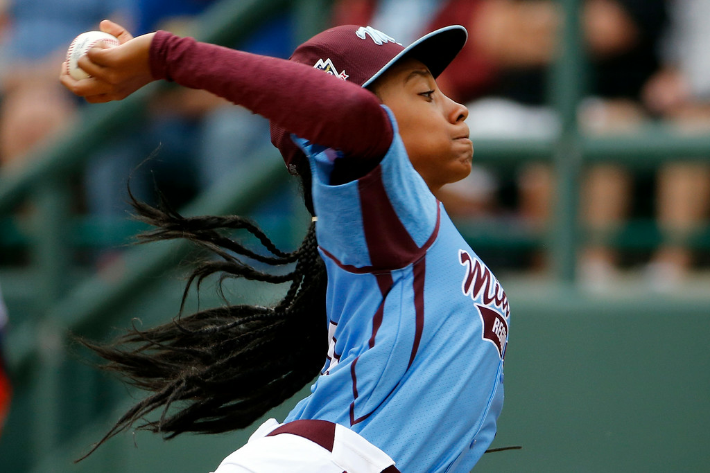 . Pennsylvania\'s Mo\'ne Davis delivers in the fifth inning against Tennessee during a baseball game in U.S. pool play at the Little League World Series tournament in South Williamsport, Pa., Friday, Aug. 15, 2014. Pennsylvania won 4-0 with Davis pitching a two-hitter. AP Photo/Gene J. Puskar)