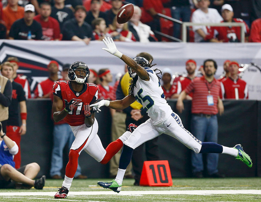 . Seattle Seahawks cornerback Richard Sherman (R) breaks up a pass intended for Atlanta Falcons wide receiver Julio Jones during the first quarter in their NFL NFC Divisional playoff football game in Atlanta, Georgia January 13, 2013. REUTERS/Chris Keane