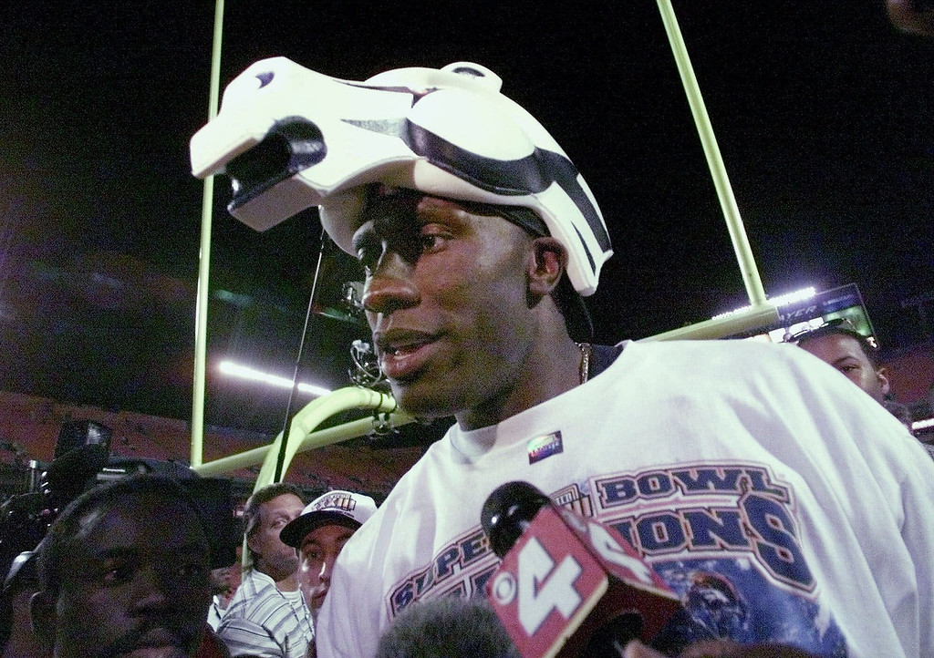 . Denver Broncos\' Shannon Sharpe wears a Broncos hat after the Broncos 34-19 win over the Atlanta Falcons in Super Bowl XXXIII in Miami, Sunday, Jan. 31, 1999. Denver tight end Shannon Sharpe twisted his left knee in the first quarter of the Super Bowl and, after appearing briefly later in the quarter, was out for the rest of the game. Sharpe was hurt when he was hit on his knee and flipped over by cornerback Ray Buchanan\'s tackle on a 14-yard reception to the Atlanta 1-yard line. (AP Photo/Dave Martin)
