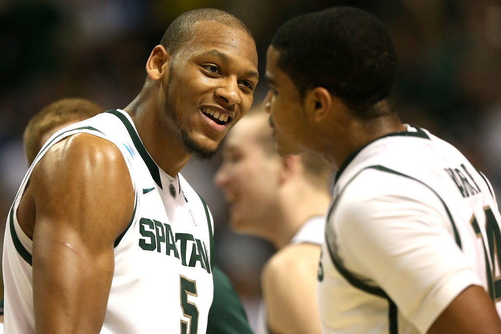 . AUBURN HILLS, MI - MARCH 23:  (L-R) Adreian Payne #5 and Gary Harris #14 of the Michigan State Spartans celebrate a play in the first half against the Memphis Tigers during the third round of the 2013 NCAA Men\'s Basketball Tournament at The Palace of Auburn Hills on March 23, 2013 in Auburn Hills, Michigan.  (Photo by Jonathan Daniel/Getty Images)