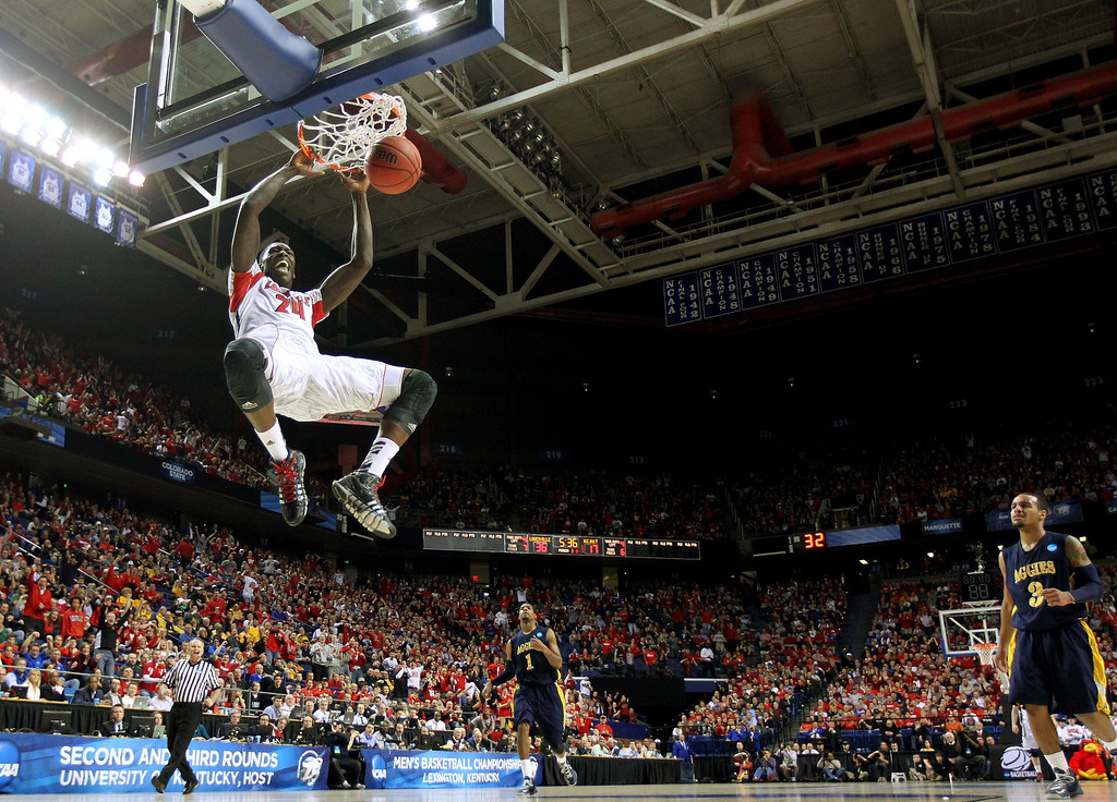 . LEXINGTON, KY - MARCH 21:  Montrezl Harrell #24 of the Louisville Cardinals dunks against the North Carolina A&T Aggies during the second round of the 2013 NCAA Men\'s Basketball Tournament at the Rupp Arena on March 21, 2013 in Lexington, Kentucky.  (Photo by Andy Lyons/Getty Images)