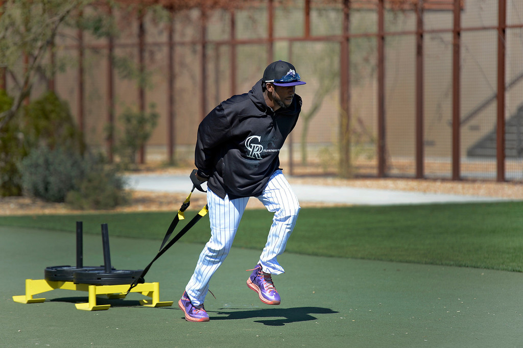 . SCOTTSDALE, AZ. - FEBRUARY 24: Dexter Fowler (24) of the Colorado Rockies pulls the sled during conditioning before their game against the Arizona Diamondbacks February 24, 2013 in Scottsdale. (Photo By John Leyba/The Denver Post)