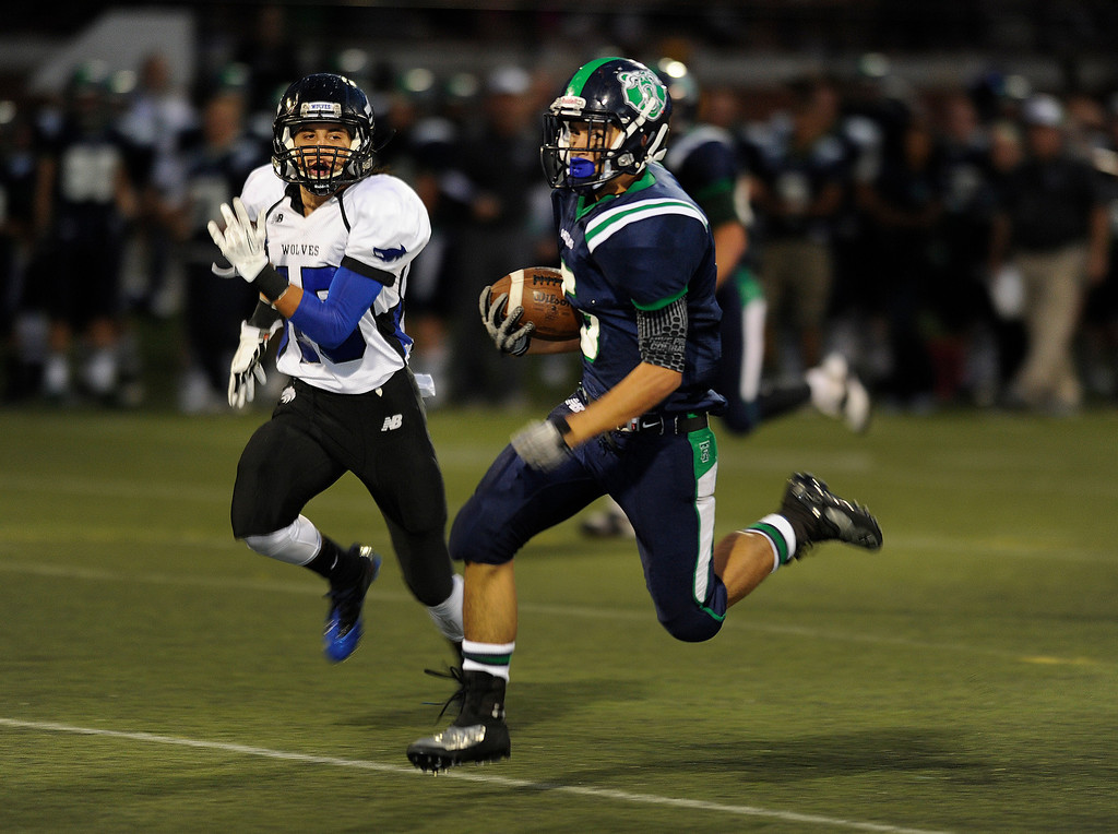 . HIGHLANDS RANCH, CO. - SEPTEMBER 13: Grizzlies\' wide receiver Jon Jones (5) found room to run after a first quarter catch. The ThunderRidge High School football team hosted Grandview at Shea Stadium Friday night, September 13, 2013.  Photo By Karl Gehring/The Denver Post