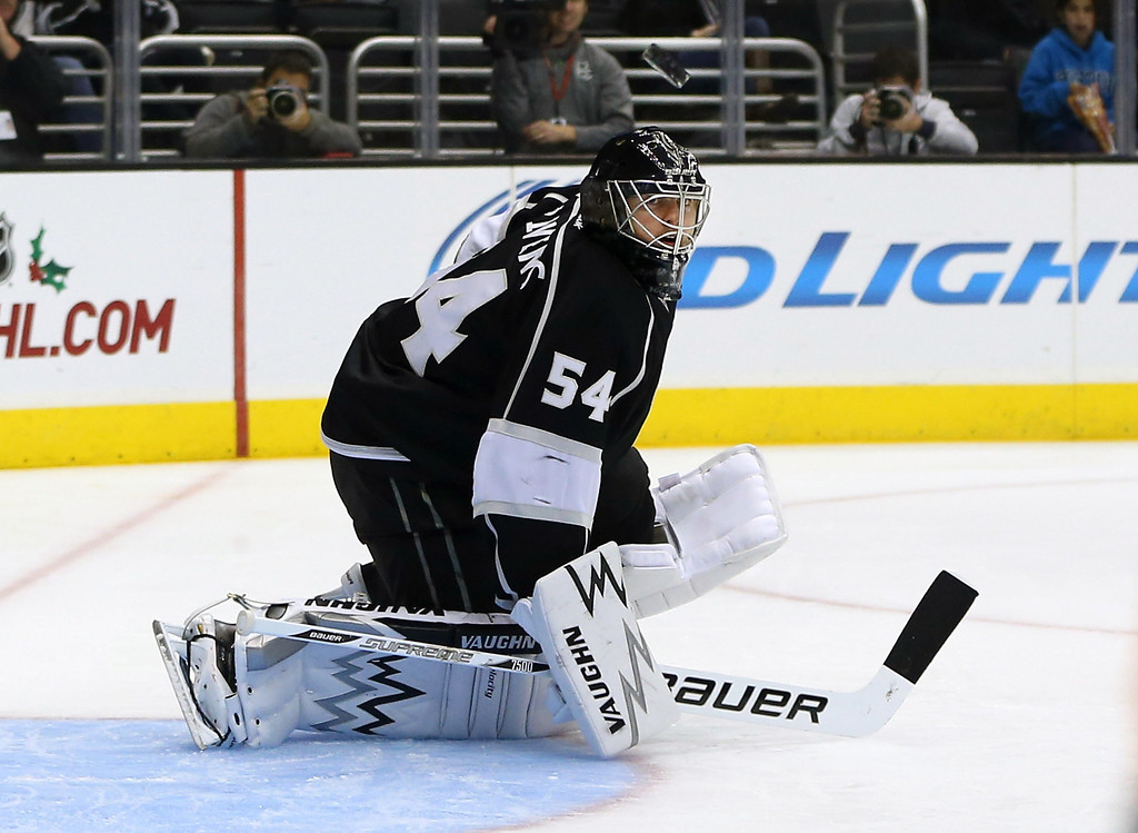 . LOS ANGELES, CA - NOVEMBER 23:  Goaltender Ben Scrivens #54 of the Los Angeles Kings makes a save in the first period during the NHL game against the Colorado Avalanche at Staples Center on November 23, 2013 in Los Angeles, California.  (Photo by Victor Decolongon/Getty Images)