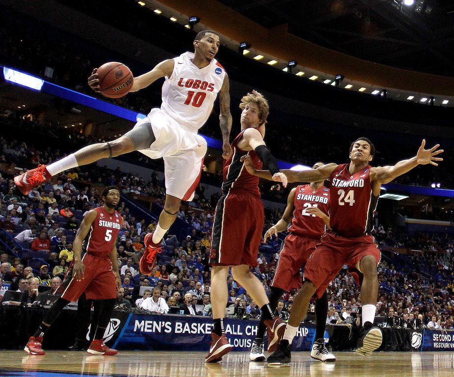 . New Mexico\'s Kendall Williams (10) passes around Stanford\'s John Gage during the second half of a second-round game in the NCAA college basketball tournament, Friday, March 21, 2014, in St. Louis. Stanford won the game 58-53. (AP Photo/Charlie Riedel)