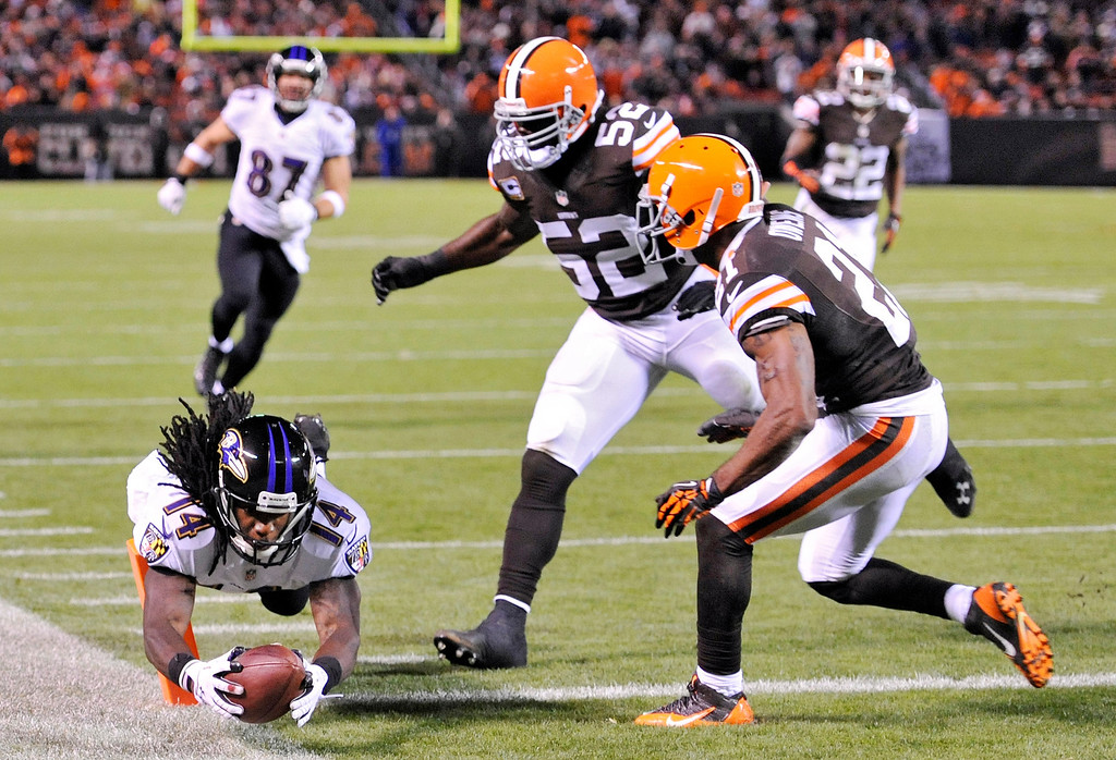 . Baltimore Ravens wide receiver Marlon Brown (14) dives into the end zone ahead of Cleveland Browns inside linebacker D\'Qwell Jackson (52) and cornerback Chris Owens on a 19-yard touchdown catch in the second quarter of an NFL football game Sunday, Nov. 3, 2013. (AP Photo/David Richard)