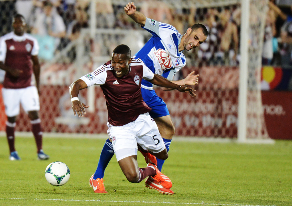 . COMMERCE CITY, CO. - June 01: Danny Mwanga of Colorado Rapids (55) fouled by Andrew Jacobson of FC Dallas (4) in the 2nd half of the game at Dick\'s Sporting Goods Park. Commerce City, Colorado. June 1, 2013. Game tied 2-2. (Photo By Hyoung Chang/The Denver Post)