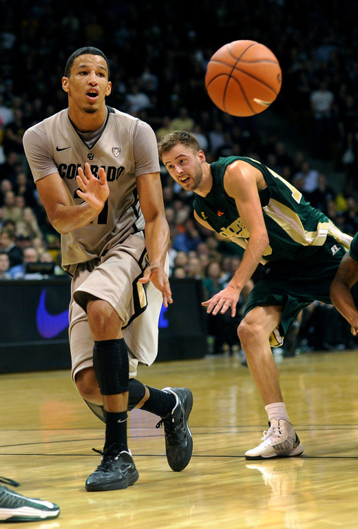 . Buffs guard Andre Roberson dished the ball off to a teammate in the second half. The University of Colorado men\'s basketball team defeated Colorado State University 70-61 at the Coors Events Center Wednesday night, November 5, 2012. Karl Gehring/The Denver Post