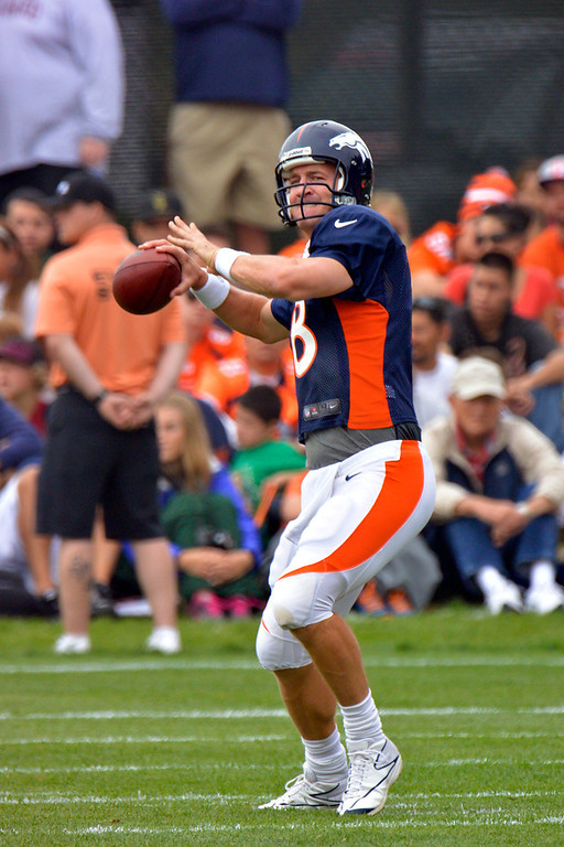. Denver Broncos QB Peyton Manning (18) throws a pass down field during training camp July 29, 2013 at Dove Valley. (Photo By John Leyba/The Denver Post)