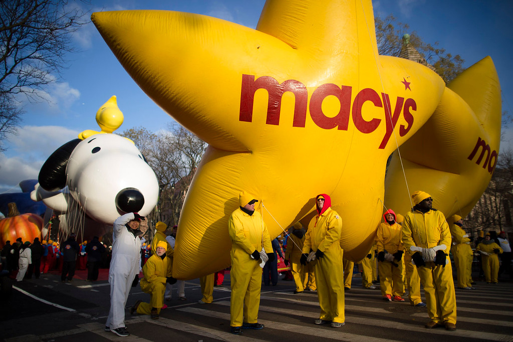 . Balloon handlers wait before the 87th Annual Macy\'s Thanksgiving Day Parade, Thursday, Nov. 28, 2013, in New York. (AP Photo/John Minchillo)