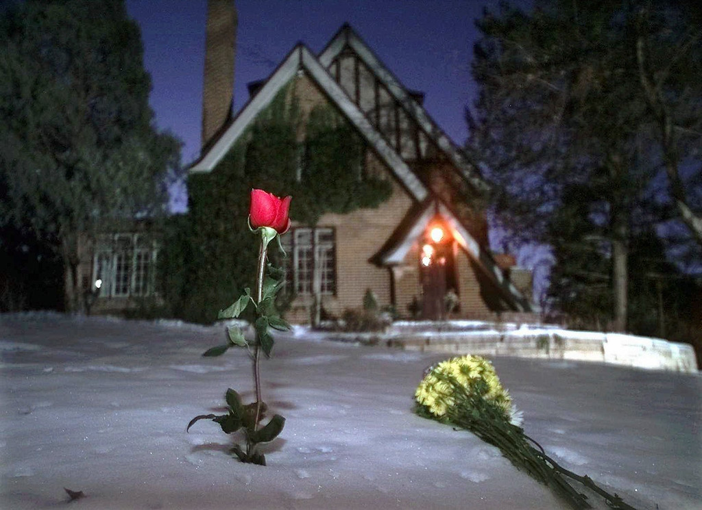 . Flowers rest in the snow outside the home of JonBenet Ramsey on the one-year anniversary of her murder, Friday Dec. 26, 1997, in Boulder, Colo. A candlelight vigil was scheduled for later in the evening. (AP Photo/Michael S. Green)