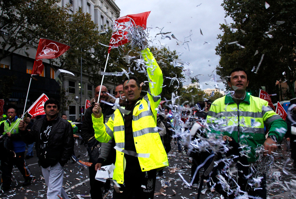 . Protestors march during a demonstration against layoffs of street cleaners and garbage collectors in Madrid, Spain, Monday, Nov. 4, 2013. Trash collectors in Madrid have started bonfires and set off firecrackers during a noisy protest in one of the Spanish capitalís main squares as they prepare to start an open-ended strike.Hundreds of street cleaners and garbage collectors who work in the cityís public parks converged on the Puerta del Sol plaza late Monday. (AP Photo/Francisco Seco)
