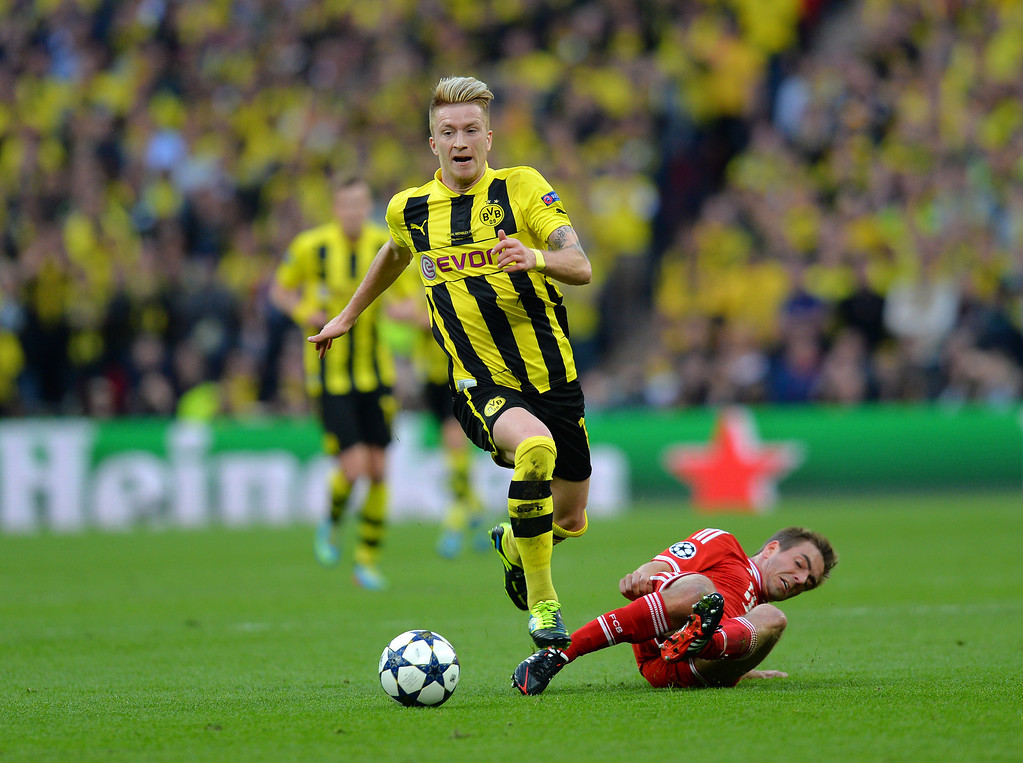 . Borussia Dortmund\'s German midfielder Marco Reus  (L) vies with Bayern Munich\'s German defender Philipp Lahm (R) during the UEFA Champions League final football match between Borussia Dortmund and Bayern Munich at Wembley Stadium in London on May 25, 2013   ANDREW YATES/AFP/Getty Images