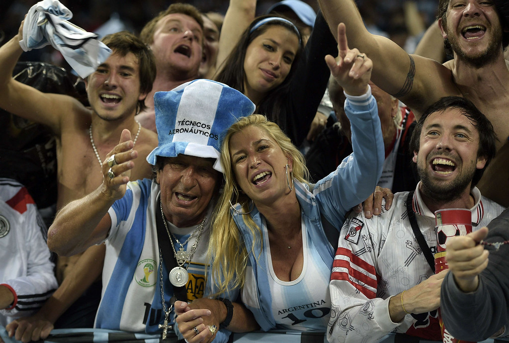 . Argentinian supporters celebrate after their victory in a penalty shoot out following extra-time in the semi-final football match between Netherlands and Argentina of the FIFA World Cup at The Corinthians Arena in Sao Paulo on July 9, 2014.  JUAN MABROMATA/AFP/Getty Images