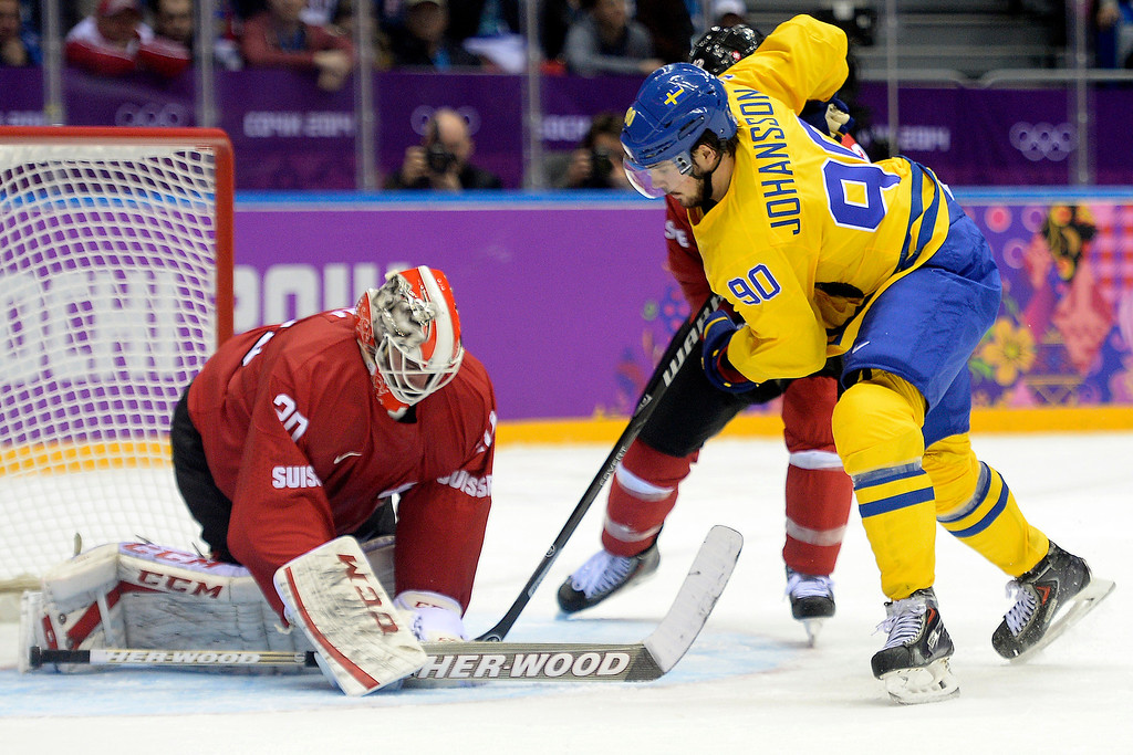 . Sweden\'s Marcus Johansson takes a shot on Switzerland\'s Reto Berra during the action at Bolshoy Arena. Sochi 2014 Winter Olympics on Friday, February 14, 2014. (Photo by AAron Ontiveroz/The Denver Post)
