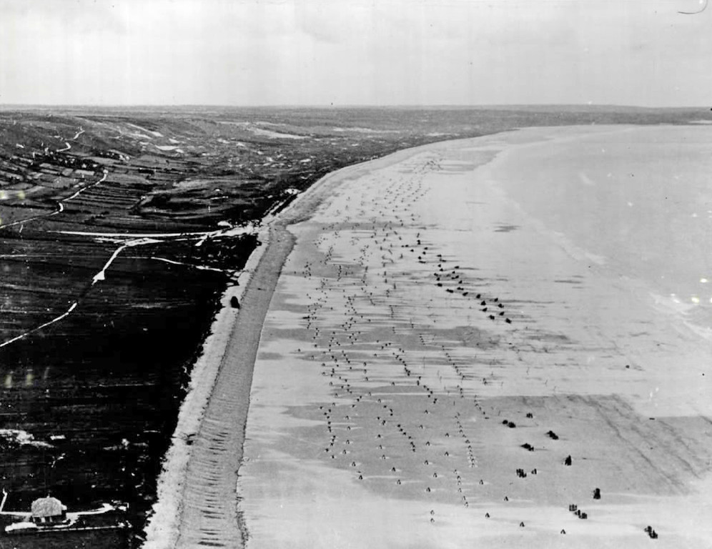 ". Beach in France before D-Day, June 6, 1944 What he was up against--Gen. Dwight D. Eisenhower, recalling the day before D-Day: ""Since the Germans had filled the beaches with terrible obstacles, steel traps of every king and had mined them to make them even more difficult to remove, we had to have low water, low tide that would give us time to clear the obstacles or at least pile through them so our landing craft could come in.\""  This photo dramatically shows what he was worried about.  Denver Post Library photo archive"