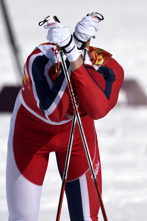 . Norway\'s Ola Vigen Hattestad crosses the finish line in the Men\'s Cross-Country Skiing Team Sprint Classic Semifinals at the Laura Cross-Country Ski and Biathlon Center during the Sochi Winter Olympics on February 19, 2014 in Rosa Khutor near Sochi. (ODD ANDERSEN/AFP/Getty Images)